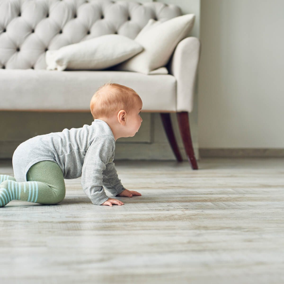 baby on luxury vinyl floor | Cherry City Interiors