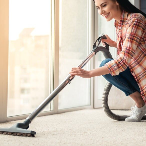 Woman clean carpet | Cherry City Interiors